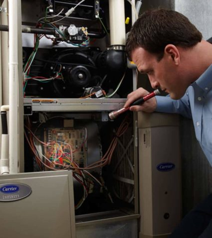 Right after finishing this gas furnace installation in Hamburg, NY, our technician thoroughly inspects their own work.