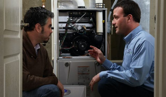 One of our heating installation specialists talks to a local homeowner here in Hamburg about their heater options.
