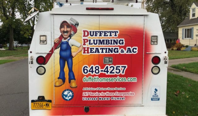 The sideview of a Duffett Plumbing, Heating & AC service vehicle, shined and ready to head out on a service call here in Hamburg, New York.