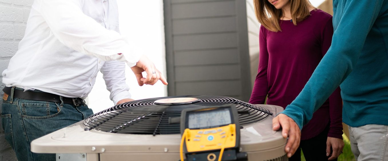 A Duffett AC technician points out the advanced features of this home's new, energy-efficient air conditioner.