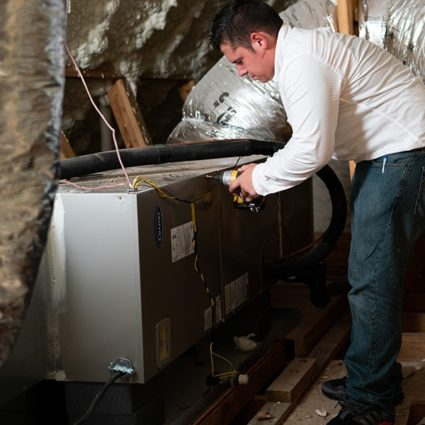 Our technician puts the finishing touches on this heating install, ensuring that this furnace is ready to provide this home with years of winter comfort.